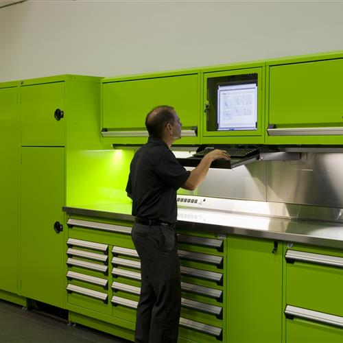 Closer angle of Rousseau green workstation with computer storage integrated in