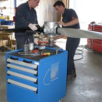 Rousseau multi-drawer cabinet in aviation facility with employees working on propeller