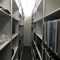 Carriages filled with open shelving on a Mobile System at an Automotive research and design center