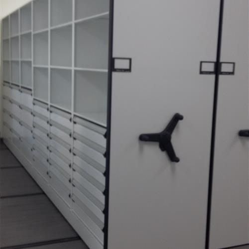 Mechanical Assist High Density Mobile System with drawers and open shelving at an Automotive research and design center
