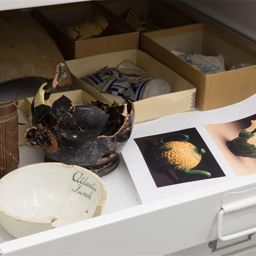 Excavated objects stored in drawers in museum cabinet mounted onto wheels