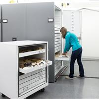 Cabinets fitted with wheels to keep artifacts organized and protected during transit