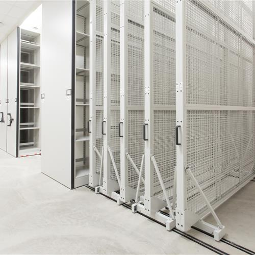 Three-dimensional objects from the university archives are stored on Spacesaver compact shelving