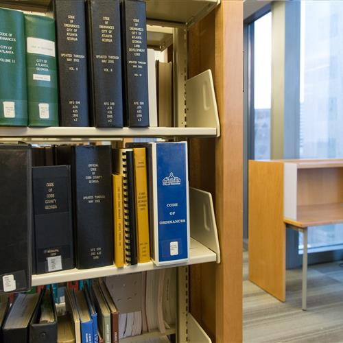 Law library organized on cantilever shelving