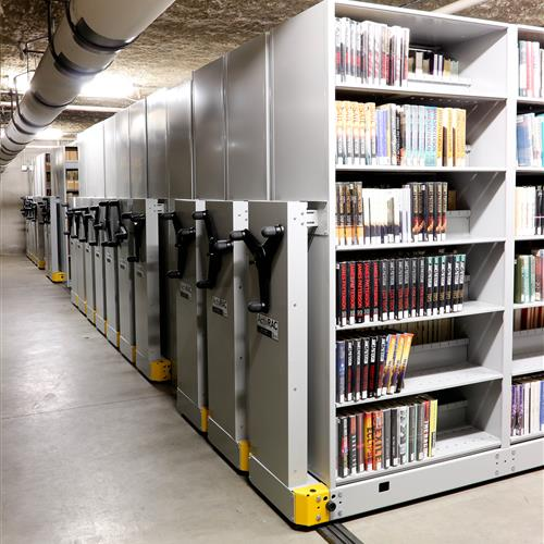 Mechanical assist library system storage solution