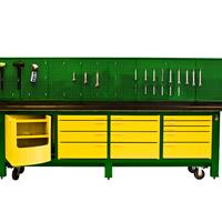 Green and yellow workbench with hanging tool wall