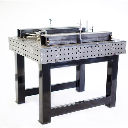 Welding table with parts on top of table