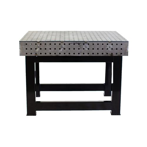 Welding table with metal holes throughout