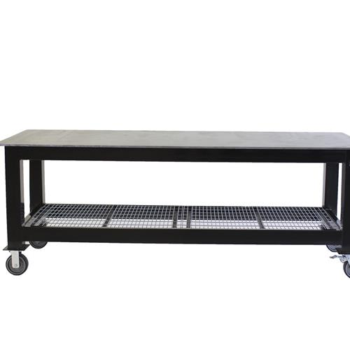 Black long welding table on casters