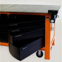 Black swivel cabinets on orange workbench