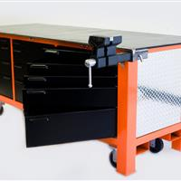 Orange workbench with black swivel cabinets