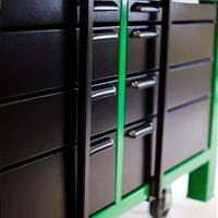 Black cabinets on green workbench