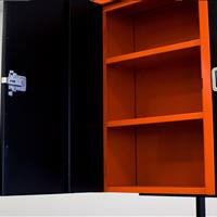 Welding table with orange cabinets