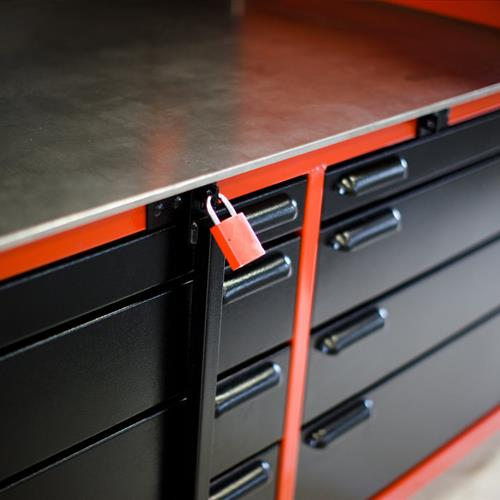 Red welding table with black cabinets and red lock