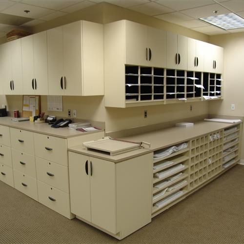 Business maliroom with tabletop, drawers, cabinets and mail slots