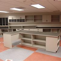 Mail room with tabletop, drawers, cabinets and mail slots
