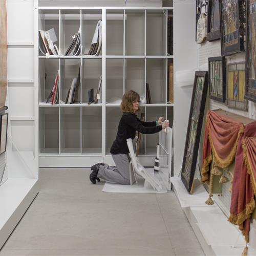 Art Racks on mobile mechanical assist allows easy access
