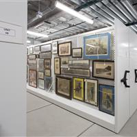 Framed art stored on mobile storage solution