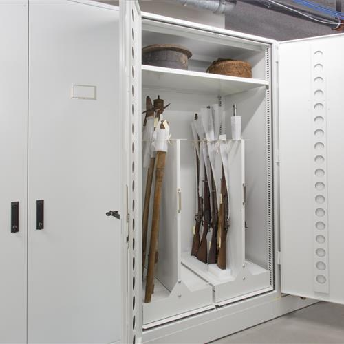 Cabinet with a pull-out gun rack