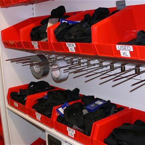 Athletic Equipment Storage using bins and pegs