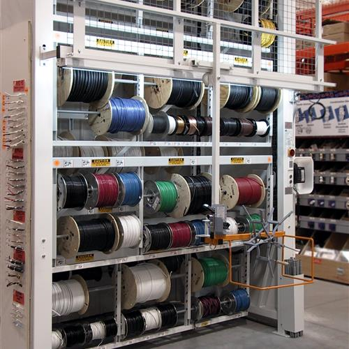 Wire spool carousel in warehouse