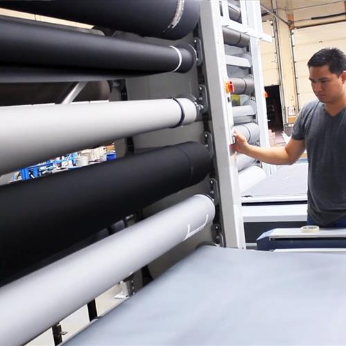 Vertical textile roll storage carousel