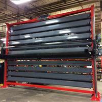 Barstock vertical lift system in manufacturing warehouse