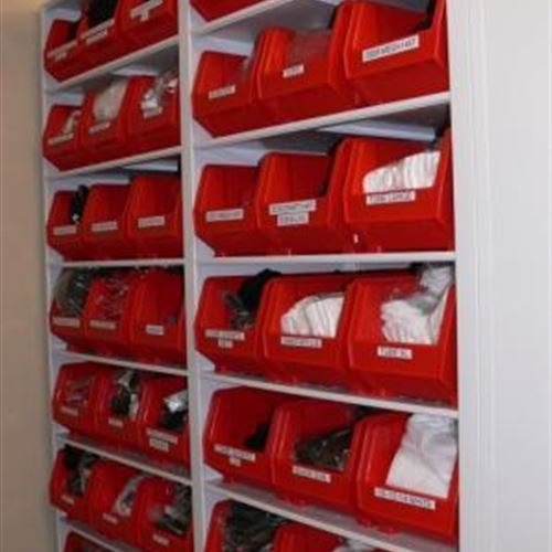 Mobile shelving with athletic gear storage in bins
