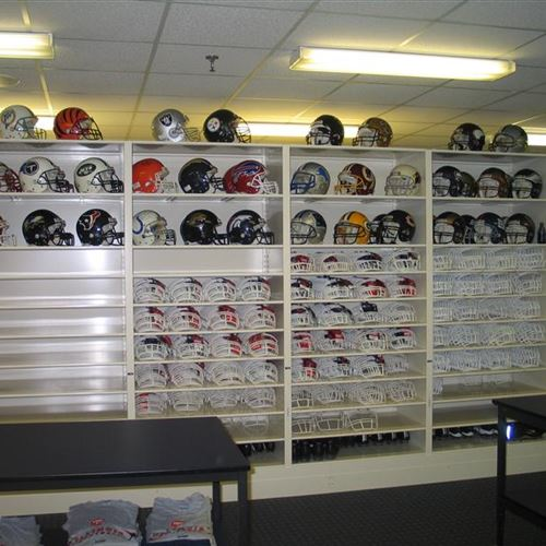 Alumni Pride Helmets displayed with Facemask storage on mobile system