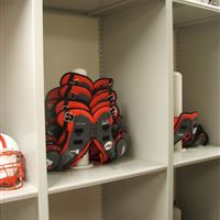 Football equipment storage of shoulder pads stacked inverted