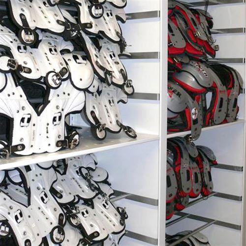 Athletic Storage of Shoulder pads on shelf with overhang