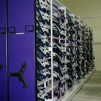 Athletic storage of shoulder pads on mobile shelving system at LSU