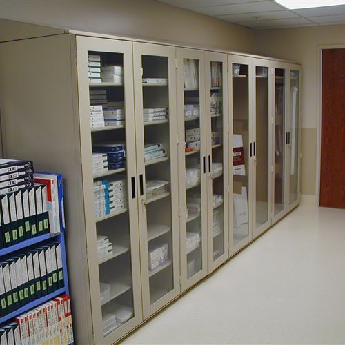 Medical Supplies In 4 Post Glass Cabinets