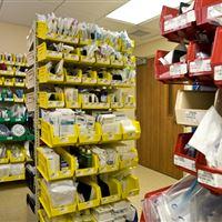 Plastic bin storage on cantilever shelving
