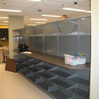 Pharmacy workstation with cantilever shelving