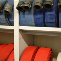 Fire hoses stored on 4-post shelving at Fort Atkinson Fire Department