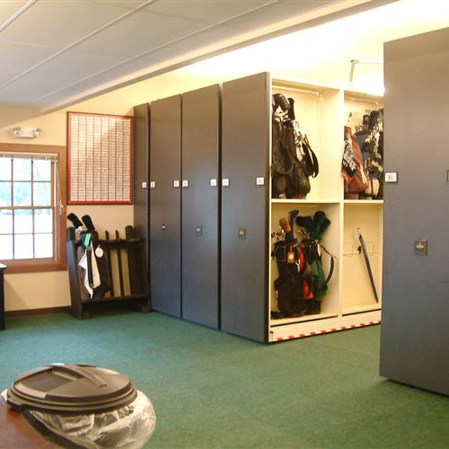 Golf bags stored on high density mobile shelving in Ozaukee Wisconsin