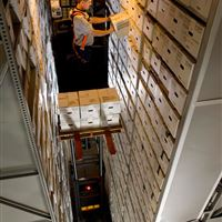 Man Elevated on XTend High Bay Warehouse Shelving in Industrial Building