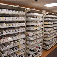Pharmaceuticals Held in Plastic Bins on Medical Storage System