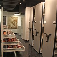 Museum archives stored on compact shelving at American Museum of Ceramic Art