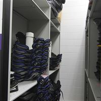 Athletic equipment storage of shoulder pads on mobile shleving