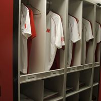 Custom Jersey Storage Cubbies on Mobile Shelving for University of Nebraska Huskers