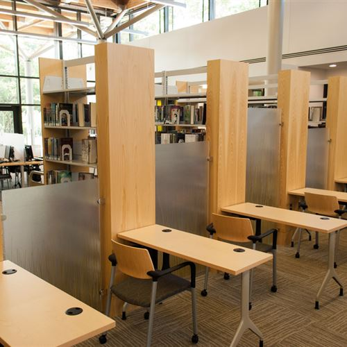 Creative Library workspaces using static shelving end panels