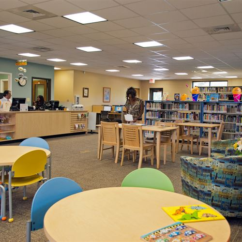 Children's reading area with cantilever library shelving