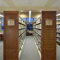Static Shelving with Custom Wood End Panels at Pewaukee Public Library